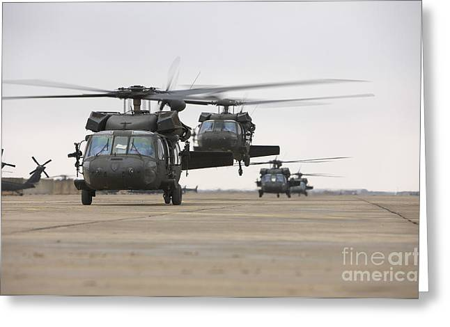 Taxiway Greeting Cards - Uh-60 Black Hawks Taxis Greeting Card by Terry Moore