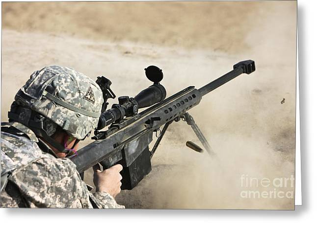 Holding Gun Greeting Cards - U.s. Army Soldier Fires A Barrett M82a1 Greeting Card by Terry Moore