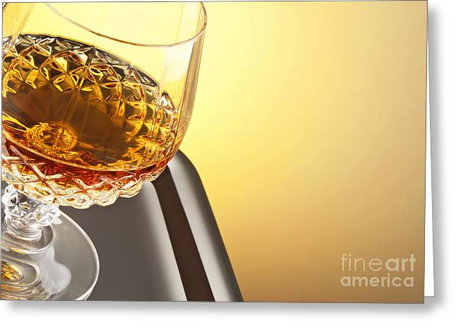 Goblet Greeting Cards - Whiskey in stem glass Greeting Card by Blink Images