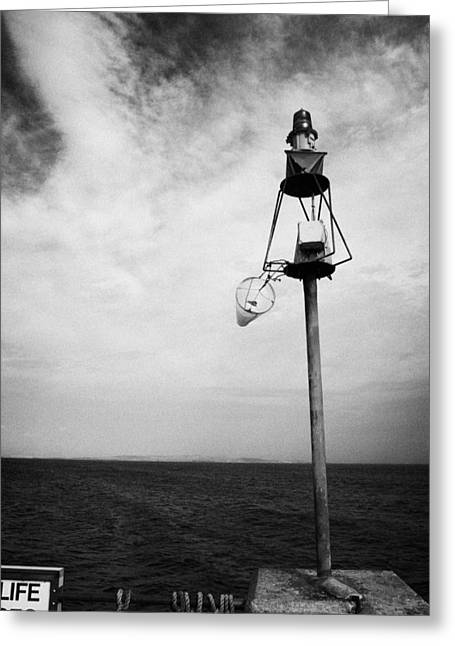 Groat Greeting Cards - windsock flying on a harbour light mast in high winds John OGroats scotland uk Greeting Card by Joe Fox