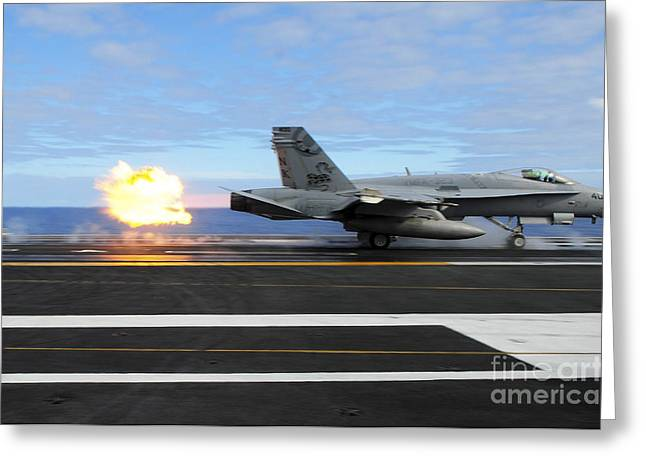 Flight Deck Greeting Cards - An Fa-18c Hornet Launches Greeting Card by Stocktrek Images