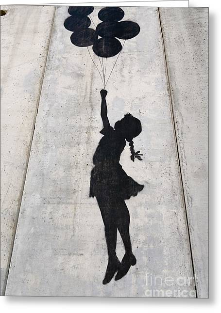 Liberation Greeting Cards - A Banksy graffiti on the separation wall in Palestine Greeting Card by Roberto Morgenthaler