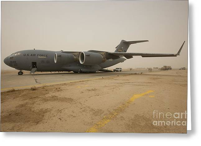 Taxiway Greeting Cards - A C-17 Globemaster Iii Sits Greeting Card by Terry Moore