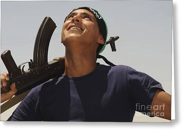 Liberation Greeting Cards - A Rebel Fighter With An Ak-47 Assault Greeting Card by Andrew Chittock