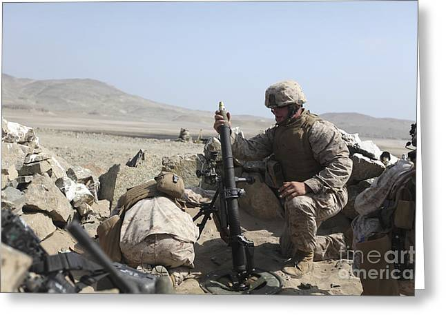 Dropping Greeting Cards - A U.s. Marine Loads A Mortar Greeting Card by Stocktrek Images