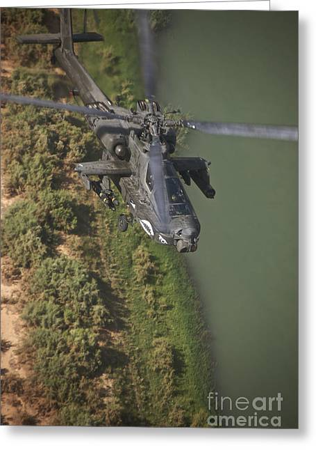 Ah-64 Greeting Cards - An Ah-64d Apache Helicopter In Flight Greeting Card by Terry Moore