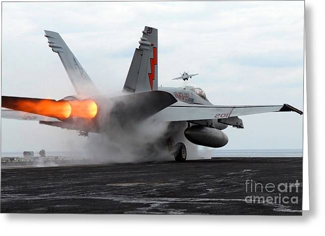 Enterprise Greeting Cards - An Fa-18c Hornet Launches Greeting Card by Stocktrek Images