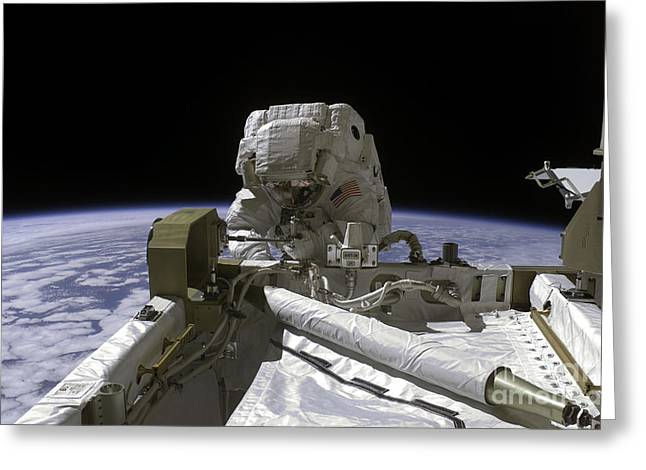 Construction Helmet Greeting Cards - Astronaut Participates In A Spacewalk Greeting Card by Stocktrek Images