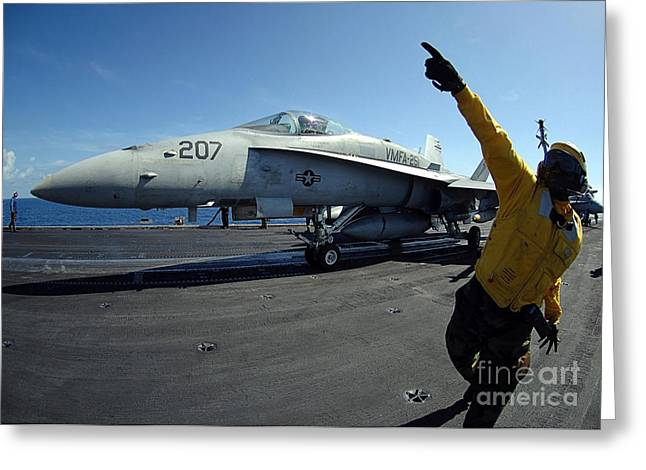 Enterprise Greeting Cards - Aviation Boatswains Mate Directs Greeting Card by Stocktrek Images