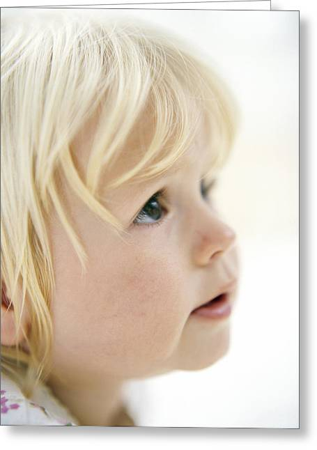 Baby Girl's Face Greeting Card by Ian Boddy