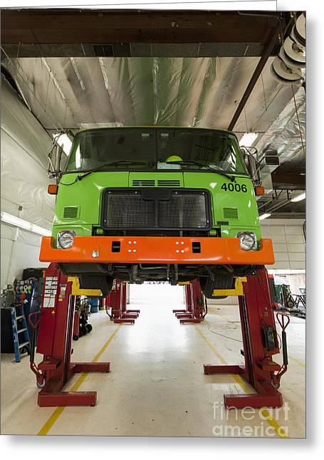 Maintenance Facility Greeting Cards - Green Garbage Truck Maintenance Greeting Card by Don Mason