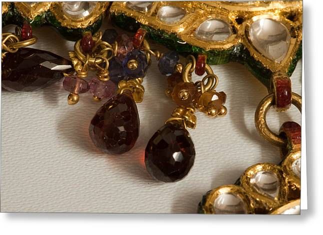 3 hanging semi-precious stones attached to a green and gold necklace Greeting Card by Ashish Agarwal