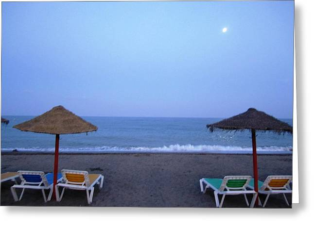 Moon Beach Greeting Cards - Moon Lit Beach Umbrellas and Chairs Costa Del Sol Spain Greeting Card by John A Shiron