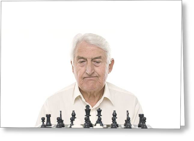 Chess Piece Greeting Cards - Senior Man Playing Chess Greeting Card by