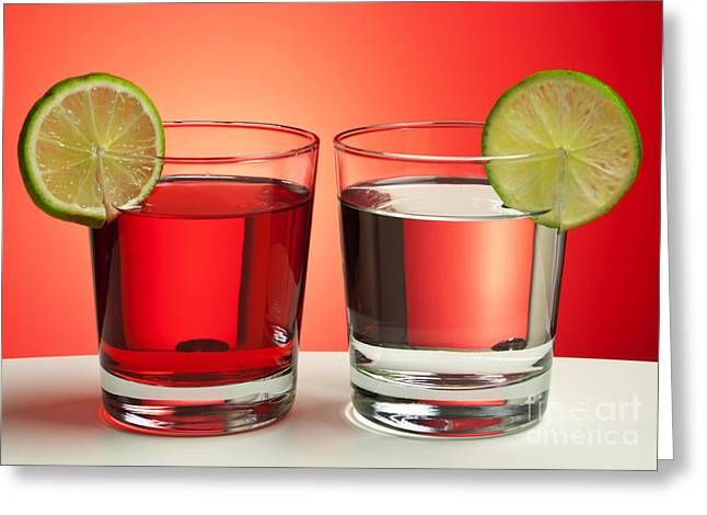 Bartender Greeting Cards - Two red drinks Greeting Card by Blink Images