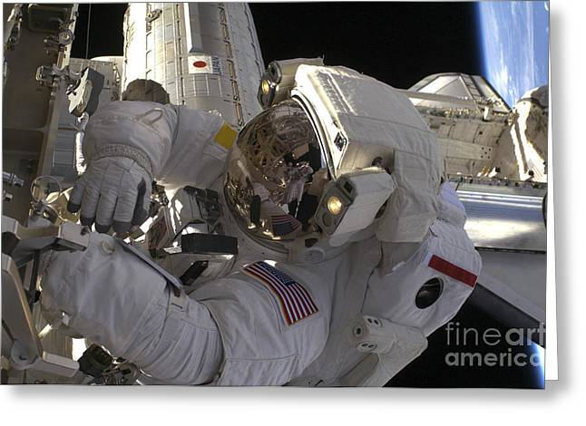 Component Photographs Greeting Cards - Astronaut Participates Greeting Card by Stocktrek Images
