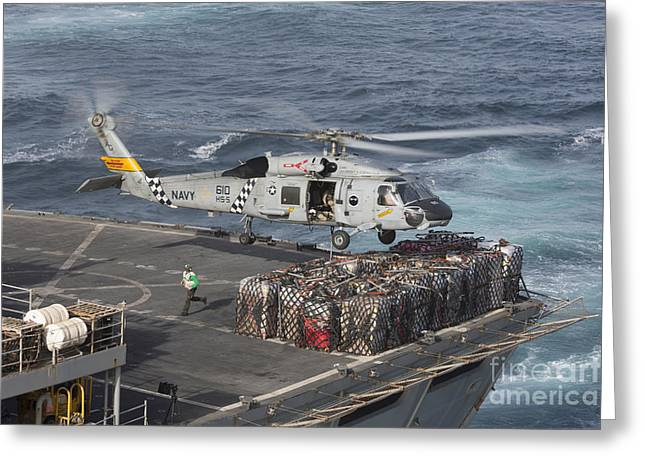 Arabian Sea Greeting Cards - A Sh-60j Seahawk Conducts A Vertical Greeting Card by Gert Kromhout