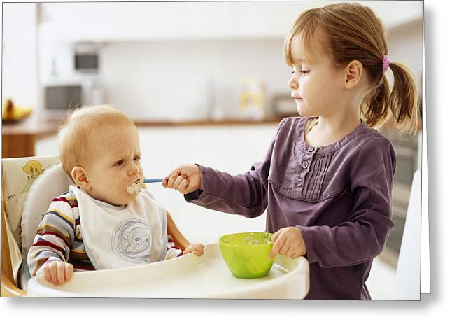 Child Care Greeting Cards - Spoon-feeding Greeting Card by Ian Boddy