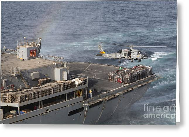 Hovering Greeting Cards - A Sh-60j Seahawk Conducts A Vertical Greeting Card by Gert Kromhout