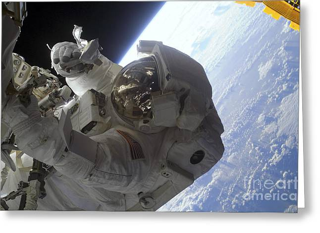 Examining Greeting Cards - Astronaut Participates Greeting Card by Stocktrek Images
