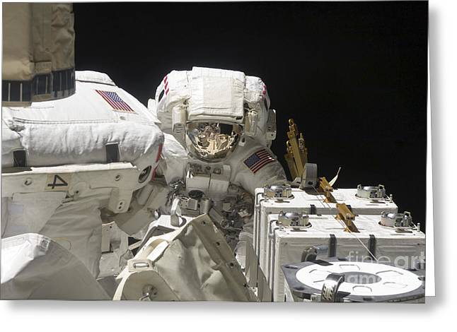Maintenance Facility Greeting Cards - Astronauts Working On The International Greeting Card by Stocktrek Images
