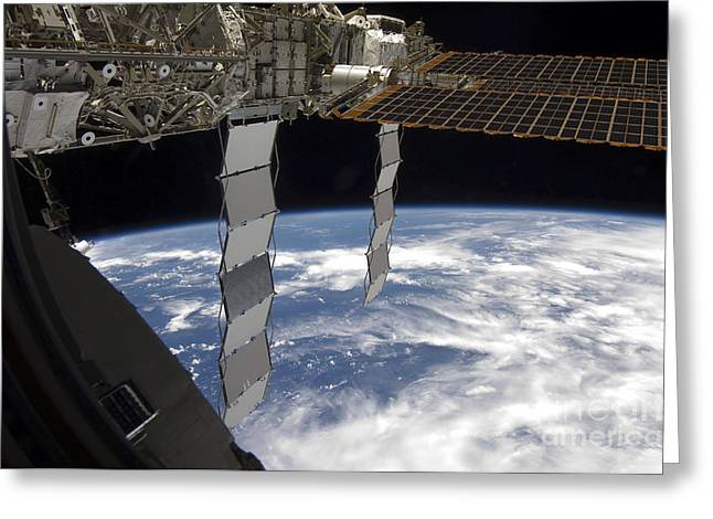 Curvature Greeting Cards - International Space Station Backdropped Greeting Card by Stocktrek Images