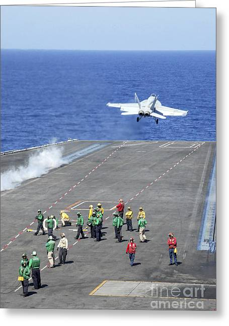 Flight Deck Greeting Cards - An Fa-18e Super Hornet Launches Greeting Card by Stocktrek Images
