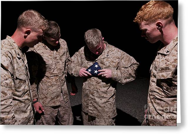 U.s. Marines Fold The American Flag Greeting Card by Terry Moore