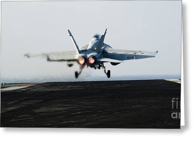 Military Airplanes Greeting Cards - An Fa-18f Super Hornet Launches Greeting Card by Stocktrek Images