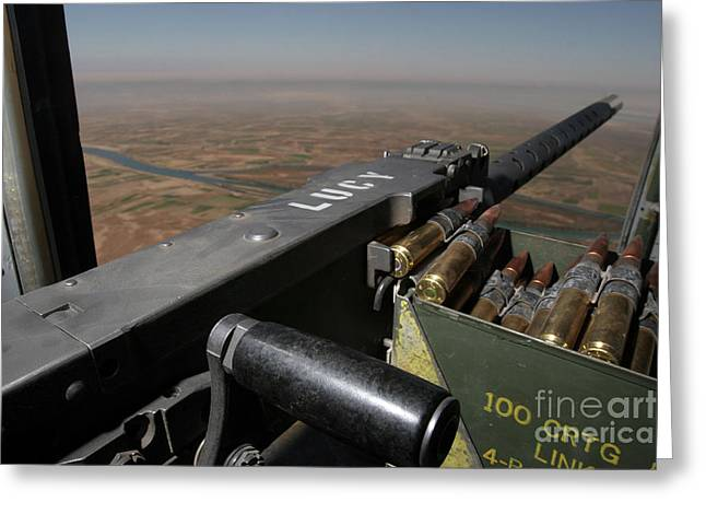 Fed Greeting Cards - A .50 Caliber Machine Gun Points Greeting Card by Stocktrek Images