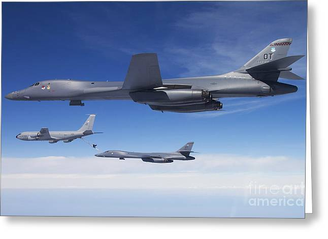 Best Sellers -  - Cooperation Greeting Cards - A B-1b Lancer Stands By As Another Greeting Card by Stocktrek Images
