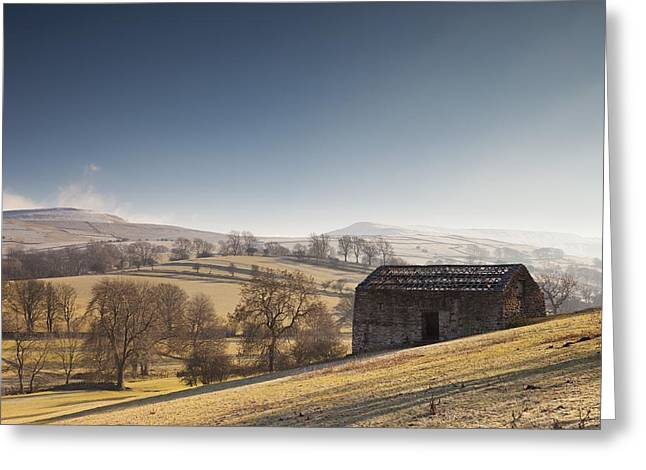 Foggy Day Greeting Cards - A Barn On A Hilly Landscape In The Fog Greeting Card by John Short