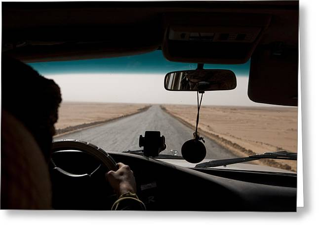 25-30 Years Greeting Cards - A Bedouin Man Drives Down An Empty Greeting Card by Taylor S. Kennedy