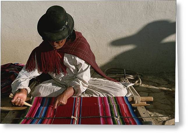National Peoples Greeting Cards - A Bolivian Woman Weaves Brightly Greeting Card by Kenneth Garrett