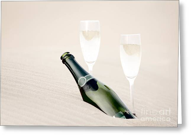 Prosecco Greeting Cards - A bottle of champagne with two glasses Greeting Card by Iryna Shpulak