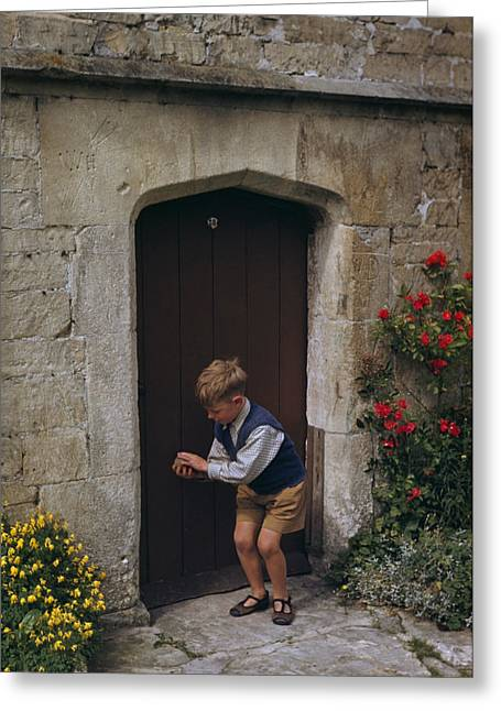 Entrance Door Greeting Cards - A Boy Bounces A Ball In Front Greeting Card by Melville B. Grosvenor