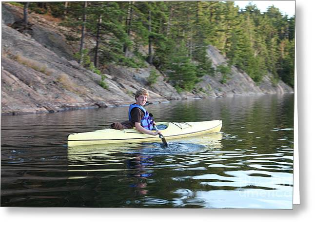 Sea Kayak Greeting Cards - A Boy Kayaking Greeting Card by Ted Kinsman