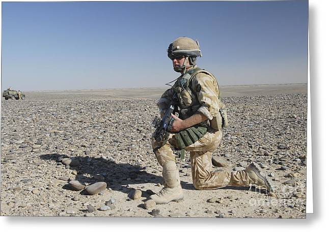 Foot Patrol Greeting Cards - A British Army Soldier On A Foot Patrol Greeting Card by Andrew Chittock