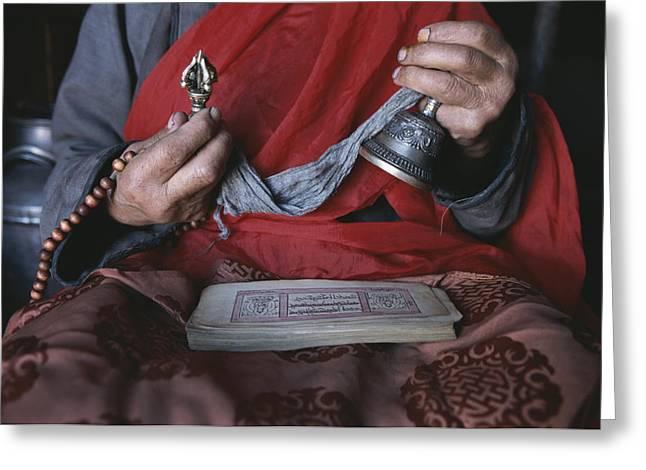 Prayer Beads Greeting Cards - A Buddhist Lama With Prayer Book Greeting Card by Gordon Wiltsie