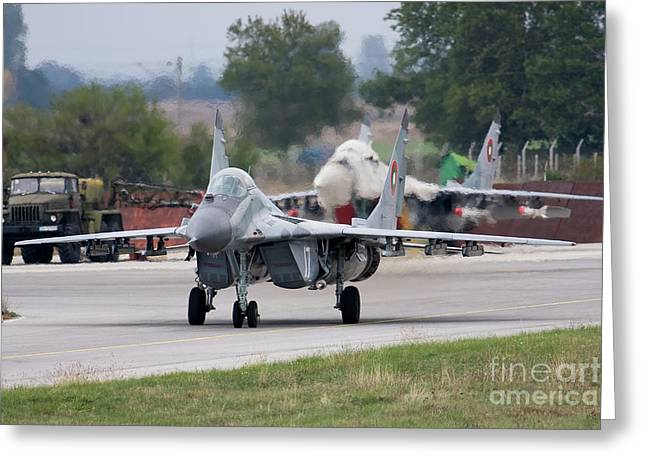 Taxiing Greeting Cards - A Bulgarian Air Force Mig-21 Taxiing Greeting Card by Anton Balakchiev