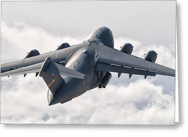 Cargo Aircraft Greeting Cards - A C-17 Globemaster Flying Greeting Card by Giovanni Colla