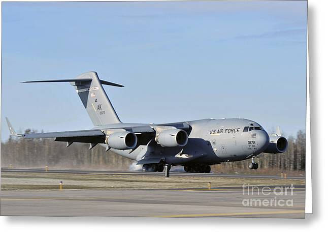 Airfield Greeting Cards - A C-17 Globemaster Iii Doing An Assault Greeting Card by Stocktrek Images