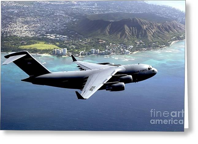 Cargo Aircraft Greeting Cards - A C-17 Globemaster Iii Flies Greeting Card by Stocktrek Images