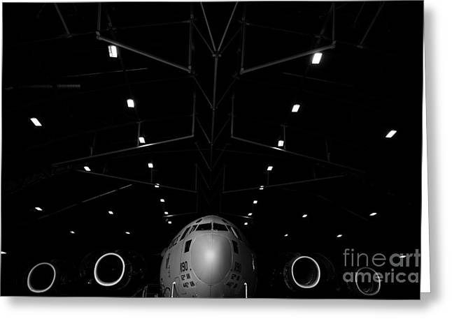 Plane Nose Greeting Cards - A C-17 Globemaster Iii Sits In A Hangar Greeting Card by Stocktrek Images