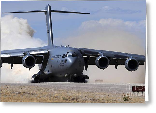 Airbase Greeting Cards - A C-17 Globemaster Lands On The Runway Greeting Card by Stocktrek Images