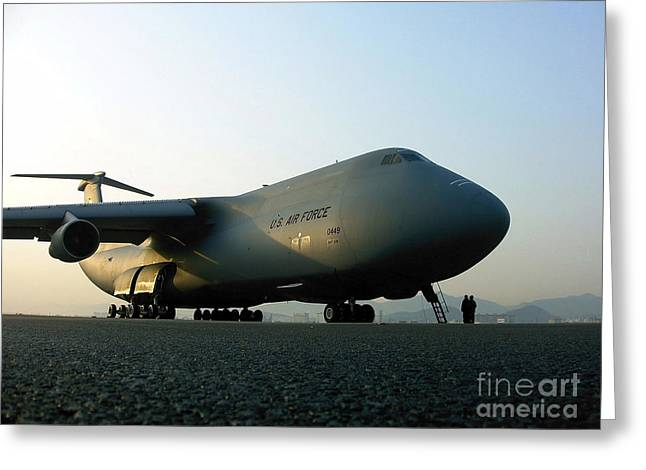 Plane Nose Greeting Cards - A C-5 Galaxy Sits On The Flightline Greeting Card by Stocktrek Images