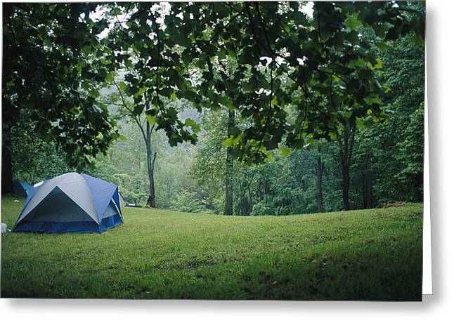 Woodland Scenes Greeting Cards - A Campers Tent Pitched In A Woodland Greeting Card by Raul Touzon