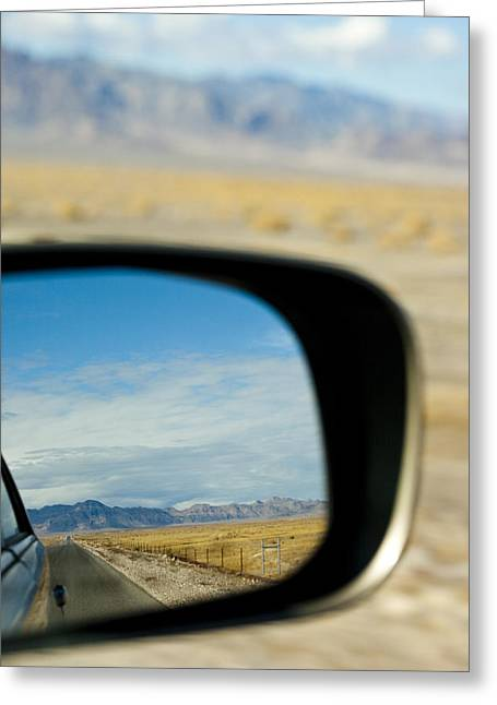 Rearview Greeting Cards - A Car Driving Through The Desert Greeting Card by Rob Casey