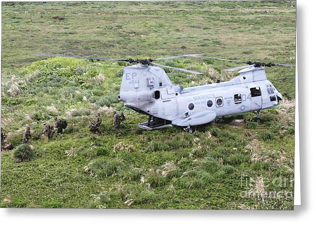 Ch-46 Greeting Cards - A Ch-46 E Sea Knight Helicopter  Drops Greeting Card by Stocktrek Images