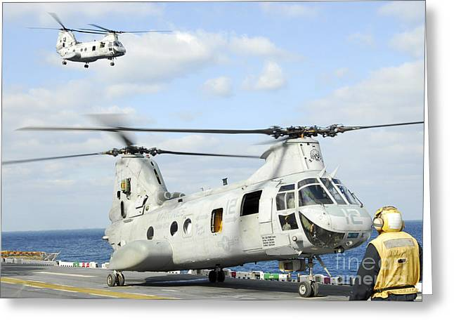 Uss Essex Greeting Cards - A Ch-46e Sea Knight Helicopter Takes Greeting Card by Stocktrek Images